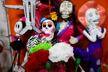 Colorful Catrina Figurines for Day of the Dead at Market in Mexico City
