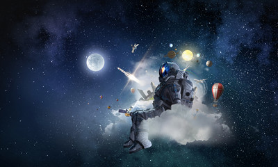 Wall Mural - Space fantasy image with astronaut. Mixed media