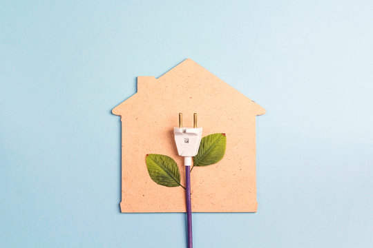 House symbol with plug like a plant on a blue  background. Save energy concept.