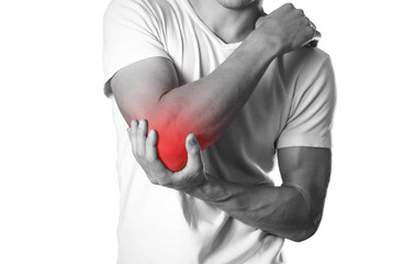A man holding hands. Pain in the elbow. The hearth is highlighted in red. Close up. Isolated on white background