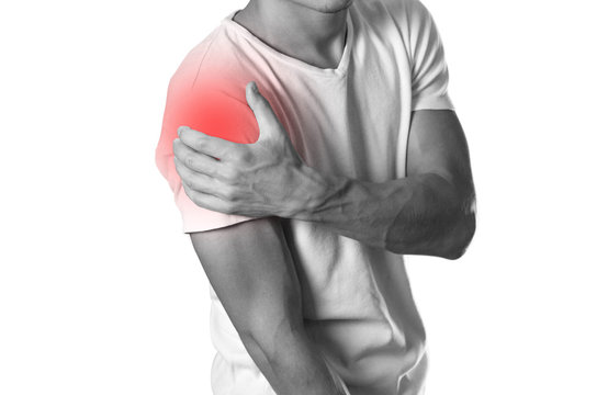 A man holding hands. Shoulder pain. The hearth is highlighted in red. Close up. Isolated on white background