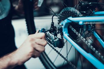 Mechanics Hand Repairing Bicycle in Bike Workshop Wall mural