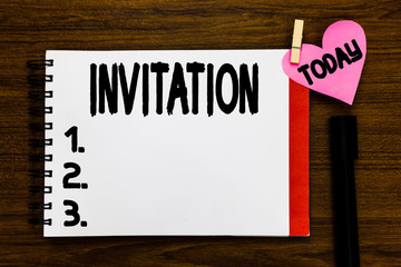 Conceptual hand writing showing Invitation. Business photo text Written or verbal request someone to go somewhere or do something Open notebook page markers holding paper heart wooden background