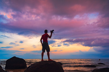 Active LifeStyle Travel photographer with camera in hand adventure on tropical island on background amazing nature landscape