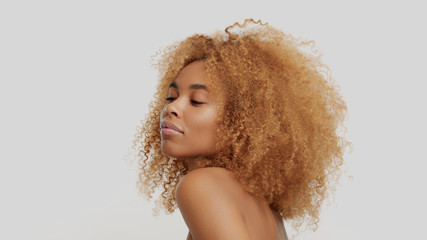 mixed race black blonde model with curly hair