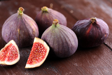 Fresh figs. Food Photo. whole and sliced figs on rustic background.