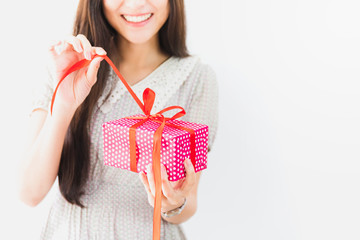 Young beautiful Asian woman open gift box.Smiling face in white background.Party and celebration concept.