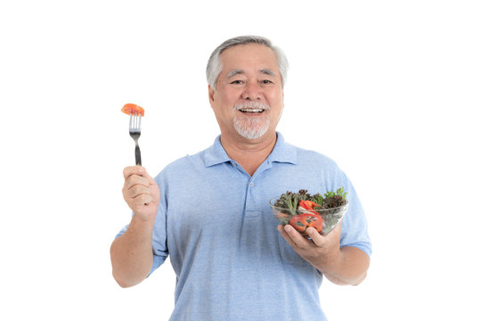 Lifestyle senior man feel happy enjoy eating diet food fresh salad isolated on white background