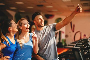 Friends making selfie in the gym