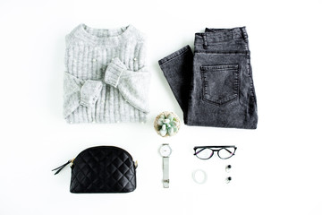 Wall Mural - Women fashion clothes and accessories. Feminine youth collage on white background top view. Flat lay female style look with warm sweater, jeans, glasses. Top view.