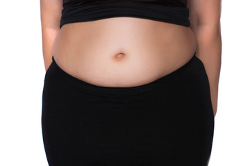 Stomach full of women on a white background - isolate. The theme of health, fullness and weight loss.