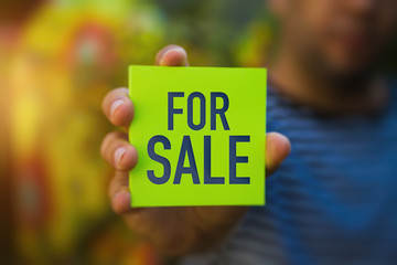 For Sale on a green note paper - Business Concept