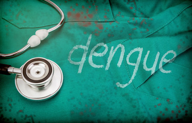 Dengue word written with white paint on a doctor's uniform next to stethoscope, conceptual image
