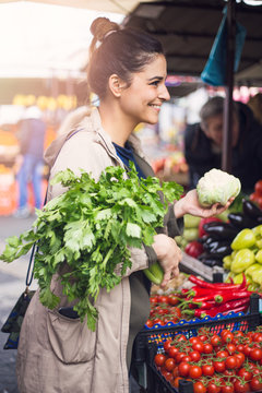 Woman on greenmarket in the city