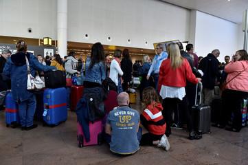 Passengers wait during a strike by Aviapartner baggage handlers at Zaventem international airport near Brussels