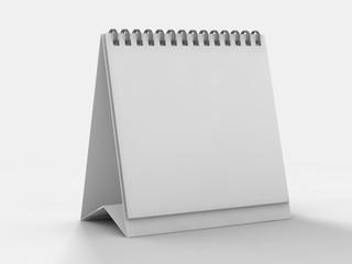 Empty desk calendar on table. Mockup design concept. 3D