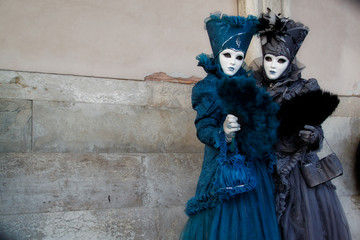 Colorful carnival blue-black mask and costume at the traditional festival in Venice, Italy