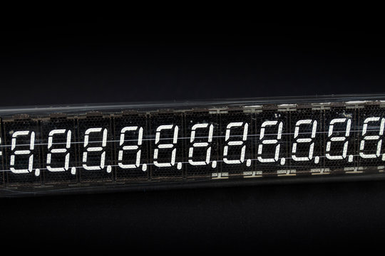 very old digital indicator close up on a black background not isolate