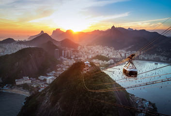 Aerial view of Rio de Janeiro at sunset with Urca and Sugar Loaf Cable Car and Corcovado mountain  - Rio de Janeiro, Brazil Fototapete