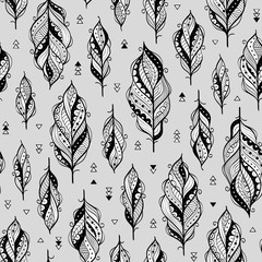 Vector seamless pattern with ethnic feathers in black and white colors. Monochrome grayscale ethnic background
