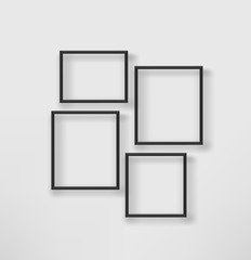 Empty black frames on a white wall. Vector template