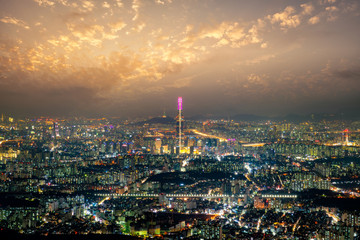 Wall Mural - Sunset scene over Seoul city view from Namhansanseong fortress. The best view of skyscrapers lit up with the han river in the background at Seoul city, South Korea