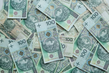 The background full of 100 zloty- polish money. Business and finance.