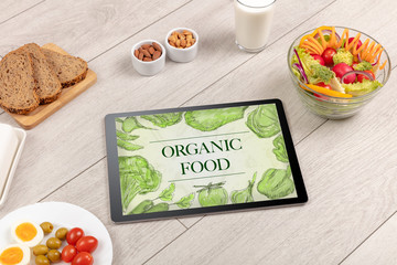 Fresh food on the table with a tablet PC.
