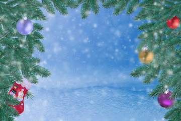 Winter landscape with snow. Christmas background with fir branch and Christmas ball.Merry Christmas and happy New Year greeting card with copy-space