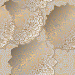 Seamless background with ornament mandala in gold color. Round arabesque design pattern.