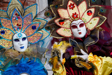 Colorful carnival multicolor mask and costume at the traditional festival in Venice, Italy