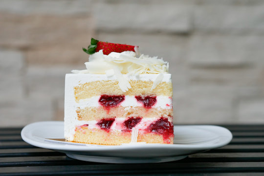 Strawberry short cake on white plate.