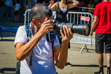 Photographer with a lens tele