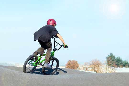 Boy in bike helmet on bmx track