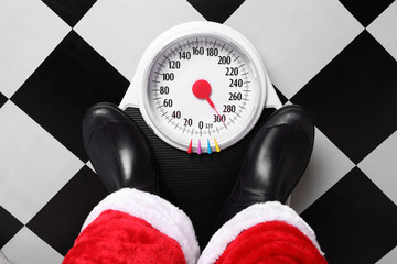Santa standing on a weight scale