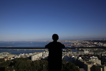 Silhouette of girl overlooking the city of Algiers, Algeria