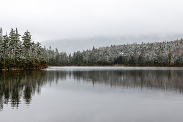 A frosty mountain lake high in the Adirondack Mountains.