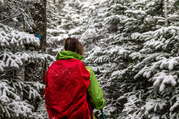 A woman enjoying the snowy forest in the Adirondack Mountains.