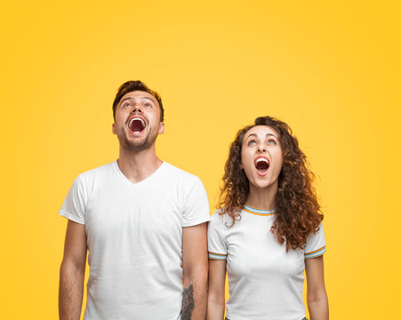 Shocked couple looking up