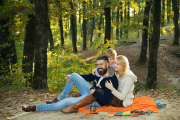 Happy Family Camping in the autumn Park. Active people concept. Outdoors. Autumn camping with kids, mother and father. Good family concept.
