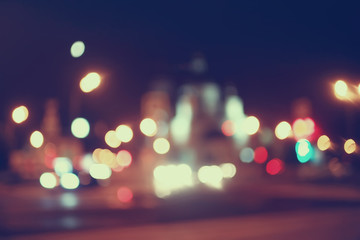 blurred bokeh city background / glare and glowing light in night city, modern beautiful bright background Fotomurales