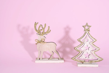 Christmas wooden tree with reindeer over light blue background.