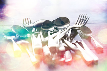 fork spoons knives background / beautiful serving tableware
