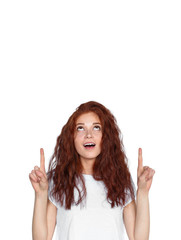 Excited ginger lady pointing up