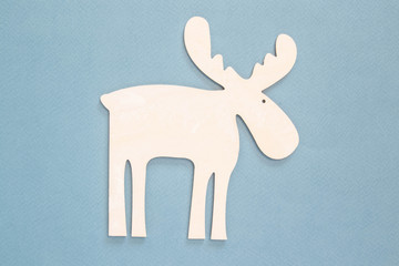 White wooden stencil of deer on a background.
