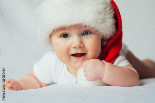 f578199e2 Cute little baby in santa hat on white background