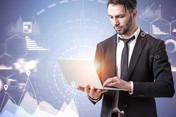 Businessman with laptop, infographics