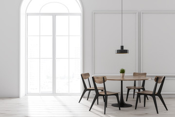 White dining room interior, round table