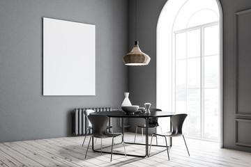 Gray dining room corner, black table, poster