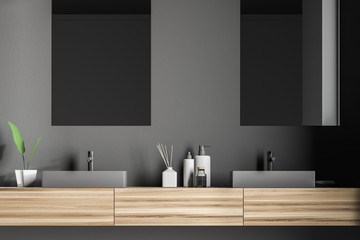Double sink and mirrors in gray bathroom